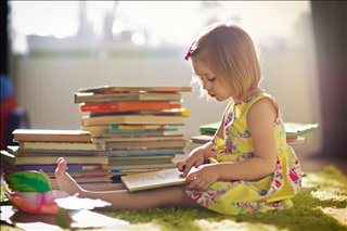 125/3882/little-girl-reading-stacks-of-books-early-childhood-literacy-childrens-books-middle.jpg